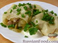 Фото к рецепту: Конверты с курицей, луком и грибочками