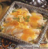 Фото к рецепту: Камбала, запеченная с рисом в лимонном соусе