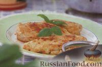 Фото к рецепту: Куриное филе, жаренное с козьим сыром и базиликом