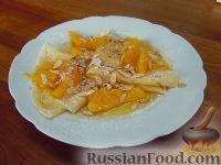 Фото к рецепту: Блины с апельсиновым соусом