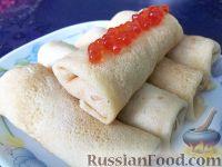 Фото к рецепту: Блинчики, фаршированные красной икрой