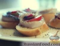 Фото к рецепту: Бутерброд с селедкой