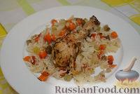 Фото к рецепту: Запеченные куриные ножки с рисом и овощами