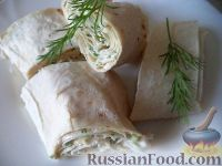 Фото к рецепту: Закусочный рулет из лаваша