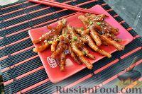 Фото к рецепту: Куриные лапки по-китайски