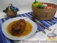 Фото к рецепту: Толстолобик, тушенный в томатном соусе