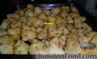 Фото к рецепту: Запеченный картофель по-польски