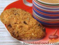 Фото к рецепту: Печенье овсяное с шоколадом и орехами