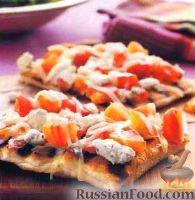 Фото к рецепту: Пицца с помидорами и козьим сыром