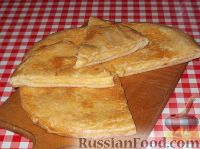Фото к рецепту: Хачапури (7)