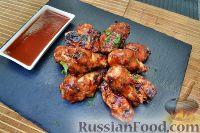 Фото к рецепту: Куриные крылья с соусом барбекю