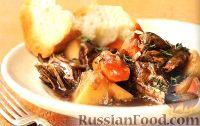 Фото к рецепту: Мясо, тушенное с овощами в вине