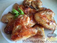 Фото к рецепту: Куриные крылышки в меду и чесноке