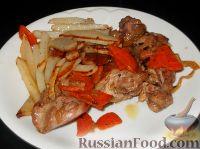 Фото к рецепту: Кролик жареный с картофелем