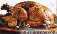 Фото к рецепту: Запеченная в духовке индейка