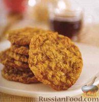 Фото к рецепту: Овсяное печенье с кокосовой стружкой