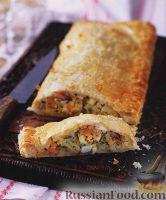 Фото к рецепту: Слоеный пирог с рыбной начинкой