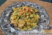 Фото к рецепту: Цыплёнок, запечённый с рисом