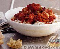 Фото к рецепту: Рис под соусом из бекона, тунца и томатов