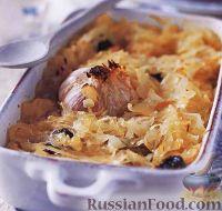 Фото к рецепту: Тушеная кислая капуста с черносливом