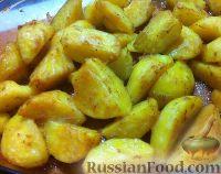 Фото к рецепту: Картофель, запеченный в соевом соусе с чесноком