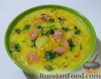 Фото к рецепту: Сырный суп с курицей, сосисками и рисом