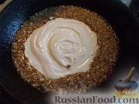 Фото приготовления рецепта: Тефтели в сметанном соусе - шаг №12