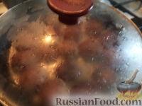 Фото приготовления рецепта: Тефтели в сметанном соусе - шаг №15
