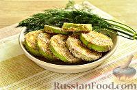 Фото приготовления рецепта: Кабачки в панировочных сухарях, запеченные в духовке - шаг №11
