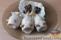 Фото к рецепту: Фаршированные кальмары