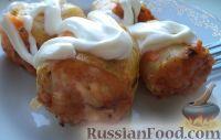 Фото к рецепту: Кабачки, фаршированные мясом и рисом, в соусе