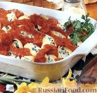 Фото к рецепту: Фаршированные макароны-ракушки с сыром и шпинатом