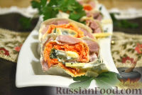 Фото к рецепту: Рулет из лаваша с сыром, ветчиной и морковкой