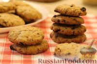 Фото к рецепту: Домашнее овсяное печенье с шоколадом и изюмом