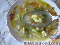 Фото к рецепту: Суп с цветной капустой и горошком