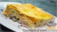 Фото к рецепту: Пирог из лаваша с сыром, грибами и ветчиной