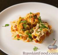 Фото к рецепту: Фаршированные конкильони (макароны-ракушки) с курицей и сыром