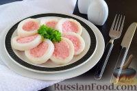 Фото к рецепту: Кальмар, фаршированный крабовыми палочками