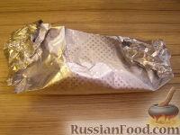 Фото приготовления рецепта: Рыба, запеченная в фольге - шаг №5