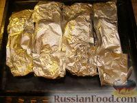 Фото приготовления рецепта: Рыба, запеченная в фольге - шаг №6