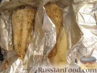 Фото приготовления рецепта: Рыба, запеченная в фольге - шаг №7