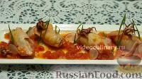 Фото к рецепту: Фаршированные кальмары в томатном соусе