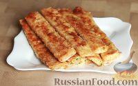 """Фото к рецепту: Закуска """"Сырные палочки"""" из лаваша"""