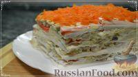 Фото к рецепту: Закусочный торт-салат с крабовыми палочками