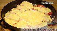 Фото к рецепту: Рыба, запеченная в духовке, с овощами