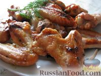 Фото к рецепту: Ароматные куриные крылышки