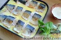 Фото к рецепту: Скумбрия, запеченная с картофелем