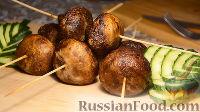 Фото к рецепту: Шашлык из шампиньонов в духовке, на шпажках