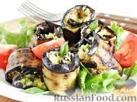 Фото к рецепту: Рулетики из баклажанов с сыром и яйцом