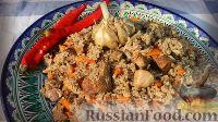 Фото к рецепту: Настоящий узбекский плов в казане на костре